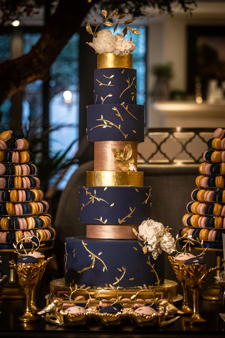 Elegant gold, navy and pink tiered cake at Kimpton Fitzroy