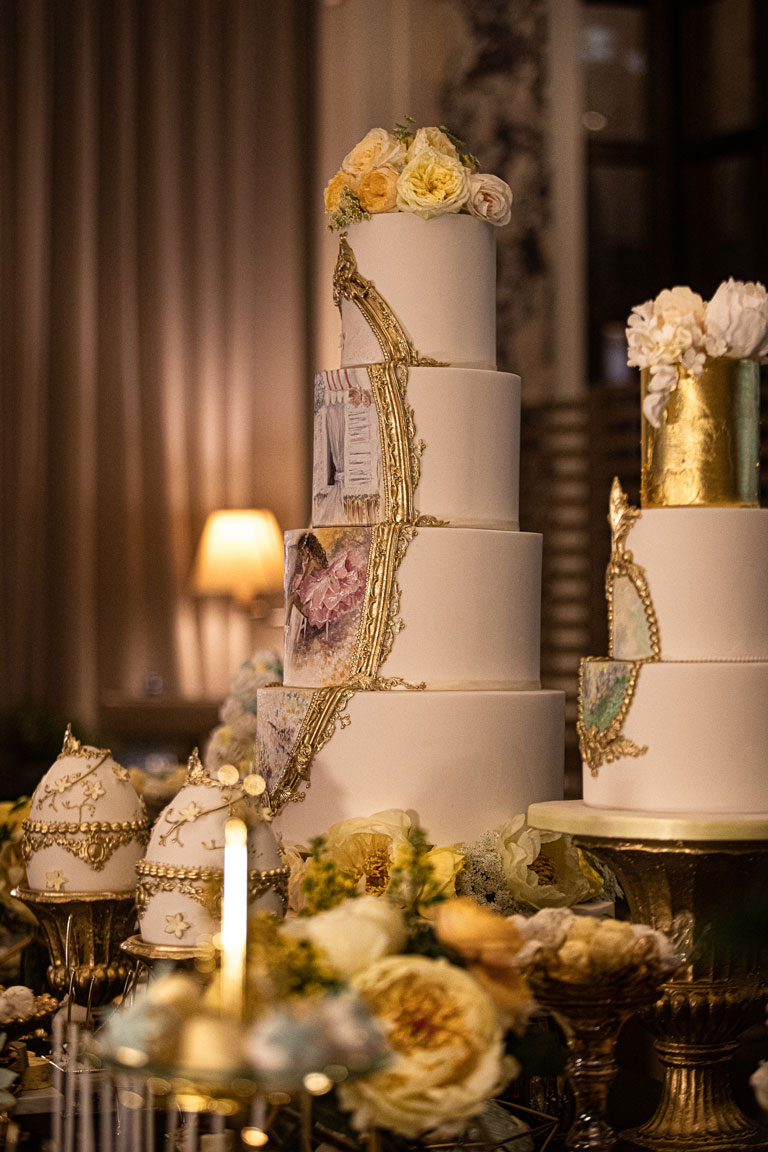 A 5 tier elegant wedding or corporate cake with a hand painted ballerina scene framed in a gold border