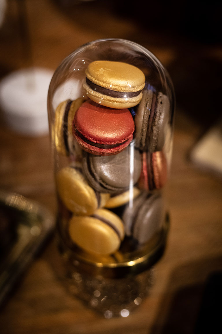 An elegant gold based cloche full of macarons by GC Couture at Maison Assouline