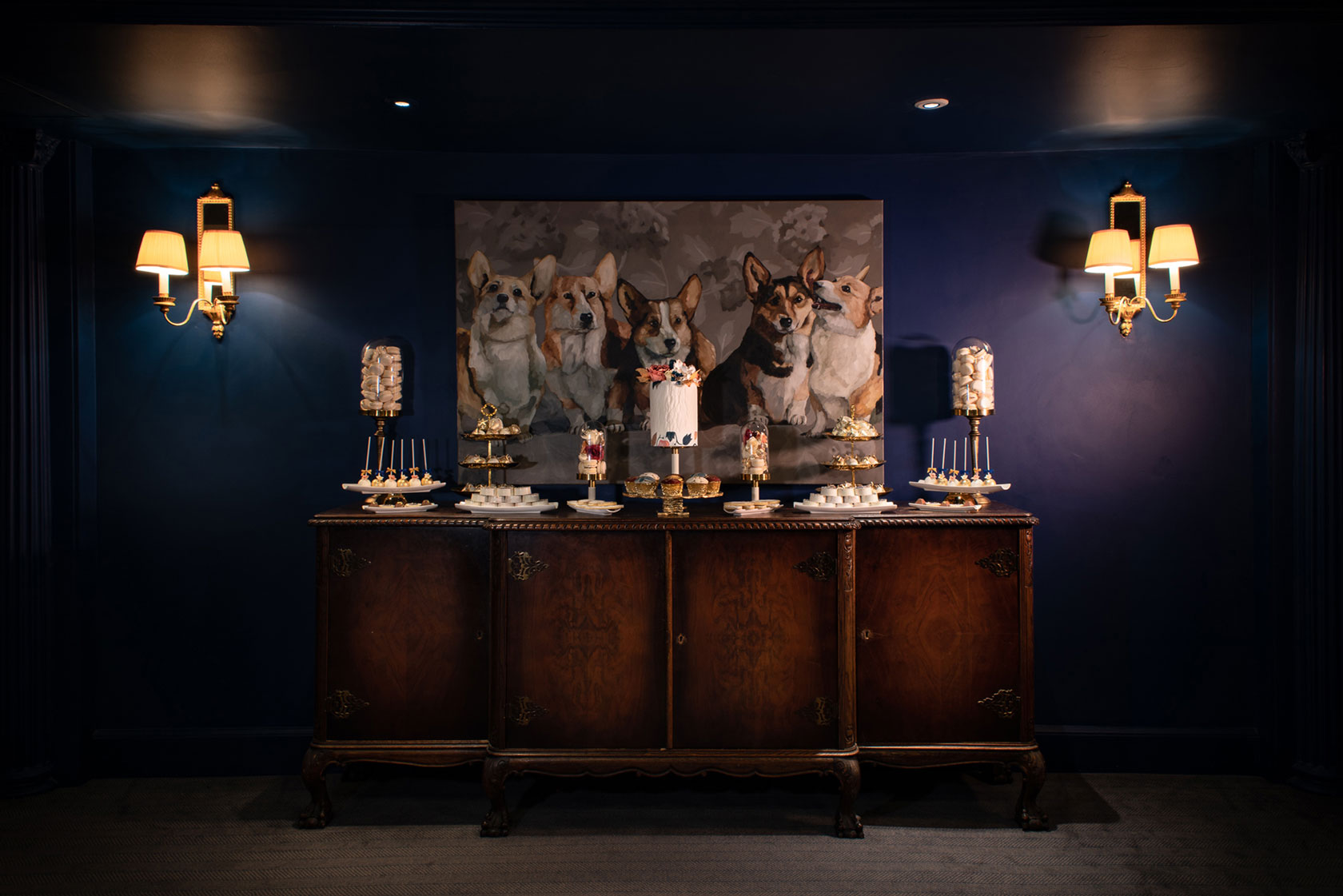 Placed in front of the magnificent portrait of the Queen's beloved Corgis, a small bespoke Indulgence Bar® by GC Couture