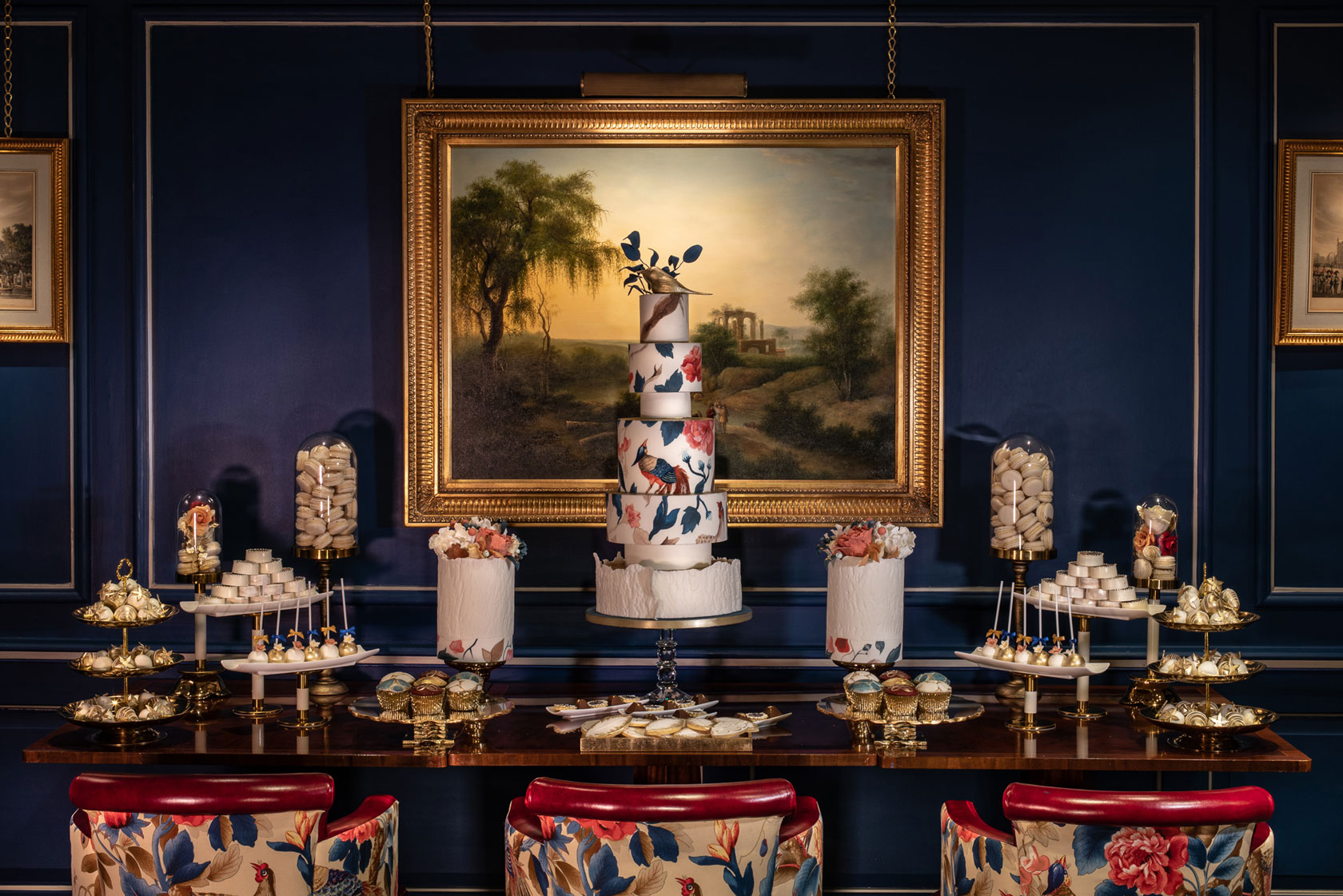An Indulgence Bar® Dessert Table by GC Couture Inside The Stafford Hotel London With An Impressive Array Of Cakes Including A 5 Tier Centrepiece Cake Alongside Macaron Toweers, Cupcakes And Chocolate Covered Strawberries